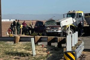 KYMA VIA ASSOCIATED PRESS                                 Law enforcement officers worked at the scene of a deadly crash involving a semitruck and an SUV in Holtville, Calif., today.