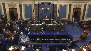 SENATE TELEVISION VIA AP                                 In this image from video, the vote total of 50-49 on Senate passage of the COVID-19 relief bill, is displayed on screen in the Senate at the U.S. Capitol in Washington.