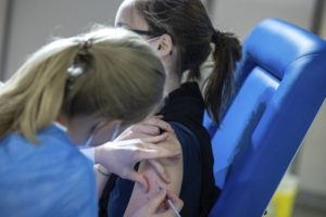 ASSOCIATED PRESS                                 A healthcare worker administered a dose of the AstraZeneca COVID-19 vaccine to a woman at the Brussels Expo Center in Brussels, Thursday. The Expo is one of the largest vaccination centers in Belgium.
