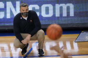 ASSOCIATED PRESS                                 Virginia head coach Tony Bennett watched play during the first half of a game against Syracuse in the quarterfinal round of the Atlantic Coast Conference tournament in Greensboro, N.C., Thursday.
