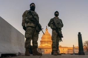 ASSOCIATED PRESS                                 National Guardsmen stood their posts around the Capitol at sunrise in Washington, Monday.