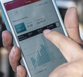COURTESY THE DALLAS MORNING NEWS VIA AP / FEBRUARY 19                                 Ivet Cantu, 45, points to her electricity bill from Griddy Energy on an app showing her energy cost of $3,114.27, during recent severe cold weather outside of her home in Dallas.
