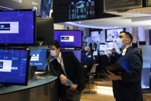 COURTESY NEW YORK STOCK EXCHANGE VIA AP                                 Craig Spector, right, works with fellow traders on the floor today.