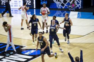 ASSOCIATED PRESS                                 Oral Roberts players celebrated after beating Ohio State in a first-round game in the NCAA men's college basketball tournament, today, at Mackey Arena in West Lafayette, Ind.