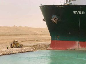 SUEZ CANAL AUTHORITY VIA AP                                 In this photo released by the Suez Canal Authority, the Ever Given sits with its bow stuck into the wall Wednesday.