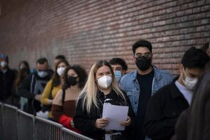 ASSOCIATED PRESS                                 People line up outside a club to be screened for the coronavirus ahead of a music concert in Barcelona, Spain. Five thousand music lovers are set to attend a rock concert in Barcelona on Saturday after passing a same-day COVID-19 screening to test its effectiveness in preventing outbreaks of the virus at large cultural events. The show by Spanish rock group Love of Lesbian has the special permission of Spanish health authorities. While the rest of the country is limited to gatherings of no more than four people in closed spaces, the concertgoers will be able to mix freely while wearing face masks.