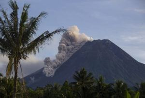 ASSOCIATED PRESS                                 Mount Merapi releases volcanic materials down its slope during an eruption in Sleman, Indonesia. Indonesia's most volatile volcano was erupting again Saturday, releasing plumes of ash high into the air and sending streams of lava and debris down its slopes. No casualties were reported.
