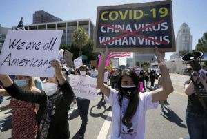 """ASSOCIATED PRESS                                 Protestors march at a rally against Asian hate crimes past the Los Angeles Federal Building in downtown Los Angeles. The gathered crowd demanded justice for the victims of the Atlanta spa shooting and for an end to racism, xenophobia and misogyny. The """"LA vs. Hate"""" initiative encourages people to call 211 if they are victims or witness an incident of hate."""