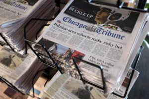 ASSOCIATED PRESS / 2016                                 Chicago Tribune and other newspapers are displayed at Chicago's O'Hare International Airport, in Chicago.