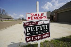 """ASSOCIATED PRESS / MARCH 16                                 A """"Sale Pending"""" sign stands along side a new driveway in Madison County, Miss."""