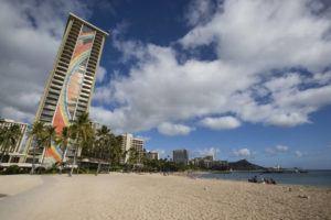 STAR-ADVERTISER                                 Beach activity was light near the Hilton Hawaiian Village Waikiki Beach Resort on Nov. 19. Hilton Hawaiian Village Waikiki Beach Resort will restart its Waikiki Starlight Luau on the Beachfront Great Lawn Friday.