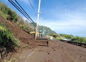 COURTESY HAWAII DOT                                 A state Department of Transportation crew clears mud and debris from a landslide off Kamehameha Highway Thursday morning near Kualoa.