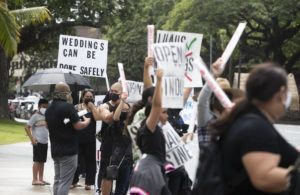 CINDY ELLEN RUSSELL / CRUSSELL@STARADVERTISER.COM                                 Wedding business owners and employees rallied at Honolulu Hale on Thursday to reopen the wedding industry after a year-long closure due to the pandemic.