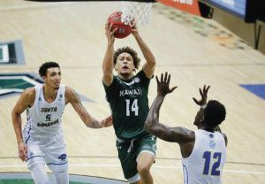 Jamm Aquino / Feb. 13                                 Hawaii guard Biwali Bayles drives to the basket between UC Santa Barbara forward Miles Norris, left, and forward Amadou Sow during the second half of a game at Stan Sheriff Center.