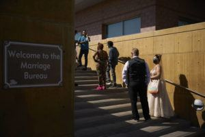 ASSOCIATED PRESS                                 Couples wait in line for marriage licenses at the Marriage License Bureau today in Las Vegas.