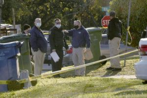 KEN BLEVINS/THE STAR-NEWS VIA AP                                 Authorities look over the scene fatal shooting Saturday, April 3, in Wilmington, N.C. Wilmington Police Chief Donny Williams says the shooting happened inside a home around midnight.