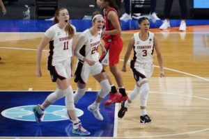 ASSOCIATED PRESS                                 Stanford forward Ashten Prechtel (11), guard Lacie Hull (24) and guard Anna Wilson (3) celebrate during the first half of the championship game against Arizona in the women's Final Four NCAA college basketball tournament today at the Alamodome in San Antonio.