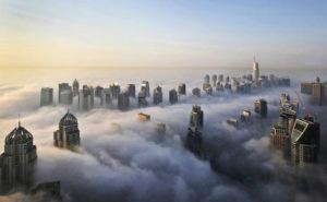 ASSOCIATED PRESS                                 A thick blanket of early morning fog partially shrouded the skyscrapers of the Marina and Jumeirah Lake Towers districts of Dubai, United Arab Emirates in Oct. 2015. Those involved in a naked photo shoot on a high-rise balcony in Dubai will be deported, authorities said today, after the footage went viral and prompted a crackdown in the Gulf Arab sheikhdom.
