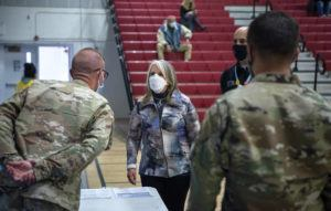 ASSOCIATED PRESS                                 New Mexico Governor Michelle Lujan Grisham talks with National Guardsmen after receiving her Pfizer COVID-19 vaccine during a vaccination event held in the gym at Desert Sage Academy in Santa Fe, N.M. on March 26.
