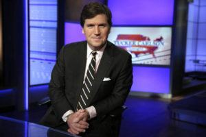 """ASSOCIATED PRESS                                 Tucker Carlson, host of """"Tucker Carlson Tonight,"""" posed for a photo, in March 2017, in a Fox News Channel studio in New York. The Anti-Defamation League has called for Fox News to fire prime-time opinion host Tucker Carlson because he defended a white-supremacist theory that says whites are being """"replaced"""" by people of color."""