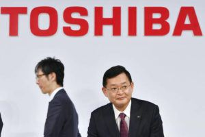 ASSOCIATED PRESS / 2018                                 Then Toshiba Corp. Chairman and CEO Nobuaki Kurumatani gets out of a seat after a press conference in Tokyo.