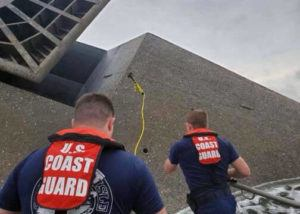 U.S. COAST GUARD VIA AP                                 In this photo provided by the U.S. Coast Guard, Coast Guard Station Grand Isle 45-foot Response Boat-medium boat crew members attempt to throw a hammer at the hull of the SeaCor Power. The crew was attempting to make contact with potential survivors inside the vessel. The Seacor Power, an oil industry vessel, flipped over Tuesday, April 13, in a microburst of dangerous wind and high seas.