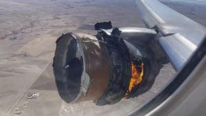 """CHAD SCHNELL VIA AP / FEB. 20                                 In this file photo taken from video, the engine of United Airlines Flight 328 is on fire after experiencing """"a right-engine failure"""" shortly after takeoff from Denver International Airport on Feb. 20. Two passengers who were on the Honolulu-bound flight are suing the company in separate suits filed today."""
