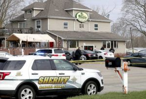 ASSOCIATED PRESS                                 Officials investigate the scene a deadly shooting at Somers House Tavern in Kenosha, Wis., today. Several people were killed and two were seriously wounded in a shooting at the busy tavern in southeastern Wisconsin early this morning, sheriff's officials said.