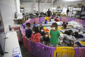 ASSOCIATED PRESS                                 Young unaccompanied migrants, from ages 3 to 9, watch television inside a playpen at the U.S. Customs and Border Protection facility, the main detention center for unaccompanied children in the Rio Grande Valley, in Donna, Texas, in March. For the third time in seven years, U.S. officials are scrambling to handle a dramatic spike in children crossing the U.S.-Mexico border alone, leading to a massive expansion in emergency facilities to house them as more kids arrive than are being released to close relatives in the United States.