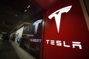 ASSOCIATED PRESS / 2019                                 A sign bearing the company logo outside a Tesla store in Cherry Creek Mall in Denver.