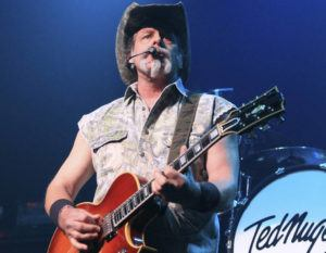 """ASSOCIATED PRESS                                 Ted Nugent performs at Rams Head Live in Baltimore on Aug. 16, 2013. Nugent revealed he was in agony after testing positive for coronavirus — months after he said the virus was """"not a real pandemic."""" """"I thought I was dying,"""" Nugent says in a Facebook live video posted Monday."""