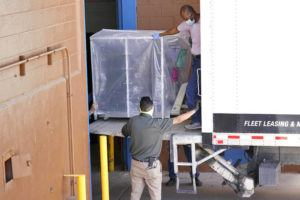 ASSOCIATED PRESS                                 Officials unload election equipment into the Veterans Memorial Coliseum at the state fairgrounds in Phoenix on April 21. Maricopa County officials began delivering equipment used in the November election won by President Joe Biden on Wednesday and will move 2.1 million ballots to the site Thursday so Republicans in the state Senate who have expressed uncertainty that Biden's victory was legitimate can recount them and audit the results.