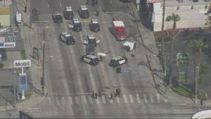 ASSOCIATED PRESS                                 This aerial image from video courtesy KTTV FOX 11 Los Angeles shows the scene of an officer-involved shooting in Los Angeles on Saturday. Police said officers shot and killed a man wearing body armor who drove his car into a police cruiser on a busy Hollywood thoroughfare.