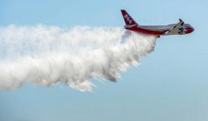 ASSOCIATED PRESS                                 A Boeing 747-400 Global SuperTanker drops half a load of its 19,400-gallon capacity during a ceremony at Colorado Springs, Colo., in 2016. The world's largest firefighting plane has been shut down just as Western states prepare for a wildfire season that fire officials fear could be worse than the average year. Tara Lee, a spokeswoman for Washington Gov. Jay Inslee, said via email April 23 that the state's Department of Natural Resources was alerted to the shutdown of the worlds' largest firefighting plane called the Global SuperTanker.