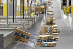 ASSOCIATED PRESS / 2019                                 Amazon packages move along a conveyor at an Amazon warehouse facility in Goodyear, Ariz.