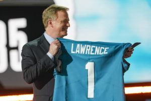 ASSOCIATED PRESS                                 NFL Commissioner Roger Goodell holds a Jacksonville Jaguars jersey as he announces that the Jaguars had chosen Clemson quarterback Trevor Lawrence with the first pick in the NFL football draft today in Cleveland.