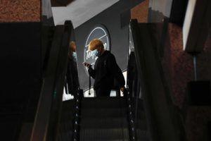 JAMM AQUINO / JAQUINO@STARADVERTISER.COM                                 A man wearing a mask walks near Bishop Street on Monday in Honolulu.