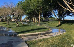 ASSOCIATED PRESS                                 Sprinklers watered grass at a park, Friday, in the Summerlin neighborhood of Las Vegas. A desert city built on a reputation for excess wants to become a model for restraint with a first-in-the-nation policy limiting water use by banning grass that nobody walks on.