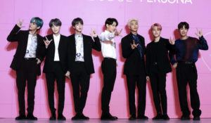 """ASSOCIATED PRESS / 2019                                 Members of South Korean K-Pop group BTS pose for photos during a press conference to introduce their new album """"Map of the Soul: Persona"""" in Seoul, South Korea."""