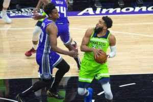 """ASSOCIATED PRESS                                 Sacramento Kings center Hassan Whiteside (20) guards Minnesota Timberwolves center Karl-Anthony Towns (32) during a game in Sacramento, Calif., today. Towns said in a Twitter post, """"Justice and Accountability! Things I never thought I would see. There's much more work to do, but this is an amazing start working toward the reform this country NEEDS!"""""""