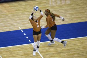 ASSOCIATED PRESS                                 Texas' Jhenna Gabriel sets the ball for Asjia O'Neal during the first set against Wisconsin.