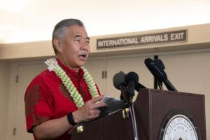 November 6, 2020 CTY-Honolulu Star-Advertiser photo by Craig T. Kojima/CKOJIMA@STARADVERTISER.COM   Governor David Ige makes his remarks. He, along with Lieutenant Governor Josh Green and Eric Takahata, Hawaii Tourism Japan  Managing Director, greeted  flight from Japan on the first day of the pre-travel testing program.