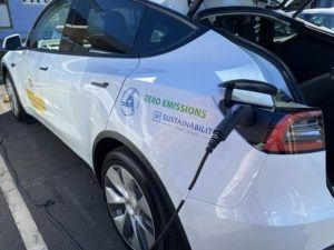 COURTESY STATE DOT                                 The Hawaii Department of Transportation picked up its first electric vehicle — a white Tesla — on Tuesday as the result of an innovative service contract that is expected to help electrify its entire light duty fleet.