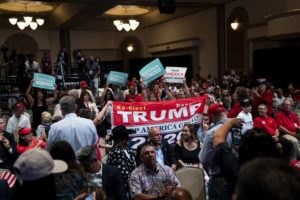 NEW YORK TIMES / 2020                                 Attendees cheer as President Donald Trump arrives for a Latinos for Trump Coalition roundtable campaign event at Arizona Grand Resort & Spa in Phoenix.