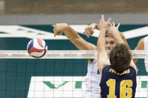 CINDY ELLEN RUSSELL / CRUSSELL@STARADVERTISER.COM                                 Hawaii middle blocker Patrick Gasman slammed a kill past San Diego middle blocker Shane Benetz during the first set of a semifinal match in the Big West men's volleyball tournament on Friday at SimpliFi Arena at Stan Sheriff Center. UC San Diego upset Hawaii in five sets but the Rainbows still received the top seed in the upcoming NCAA tournament.