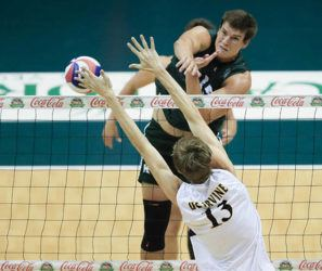 JAMM AQUINO/ JAQUINO@STARADVERTISER.COM                                 Hawaii middle blocker Patrick Gasman puts a kill past UC Irvine middle blocker Scott Stadick (13) during the first set of a men's NCAA volleyball game on Saturday at Stan Sheriff Center in Honolulu. Gasman became the Big West's first four-time first-team all-conference selection today.