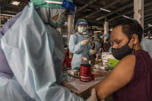 NEW YORK TIMES / MARCH 17                                 A man receives a COVID-19 vacine during a vaccination drive in Bangkok, Thailand.