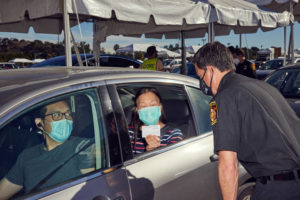 NEW YORK TIMES / JANUARY 20                                 A COVID-19 vaccination drive-thru site at Dodger Stadium in Los Angeles.