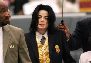 ASSOCIATED PRESS / 2005                                 Michael Jackson arrives at the Santa Barbara County Courthouse for his trial in Santa Maria, Calif.