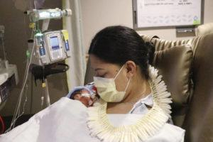 """TAYLOR URSULUM/HAWAII PACIFIC HEALTH VIA ASSOCIATED PRESS                                 Lavinia """"Lavi"""" Mounga held her son Raymond Mounga at Kapiolani Medical Center for Women & Children in Honolulu. Mounga had no idea the baby was coming when she went into labor on a flight from her home in Utah to Honolulu the week before. """"I just didn't know I was pregnant, and then this guy just came out of nowhere,"""""""